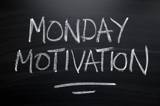 The words Monday Motivation written by hand in white chalk on a blackboard as a reminder