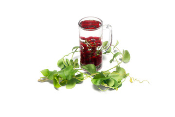 A transparent glass of water and berry with giloy leaf. Isolated on white background.
