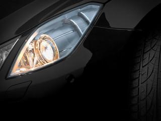 Headlights of a black car. Fragment