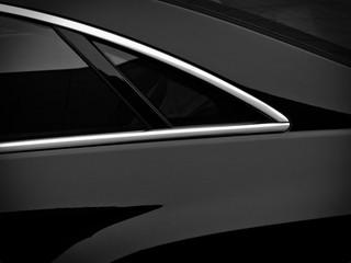 Rear side window on a black passenger car. Fragment