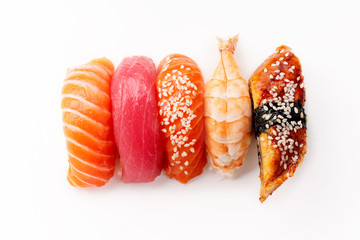 Creative layout with various sushi with eel, shrimp, salmon and tuna  on white background