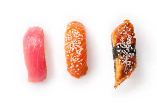 Creative layout with various sushi on white background. Shrimp, eel, tuna.