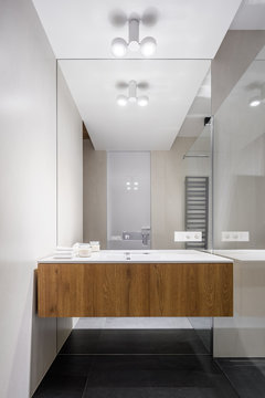 Small bathroom with big mirror