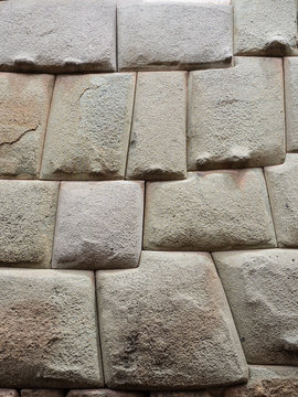 Ancient inca stone wall in the city of Cusco, Peru