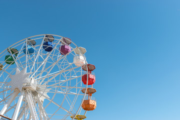 Acrylic Prints Amusement Park Colourful ferris wheel in the amusement park Tibidabo on background of blue sky, Barcelona, ​​Spain.