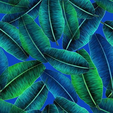 Transparent tropical banana leaves, jungle leaf seamless floral pattern blue background. Artistic palms pattern with seamless repeating design. Pattern for summer designs.