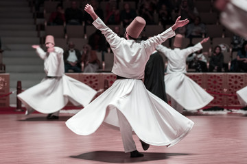 Unidentified whirling Dervishes or Semazen in Konya