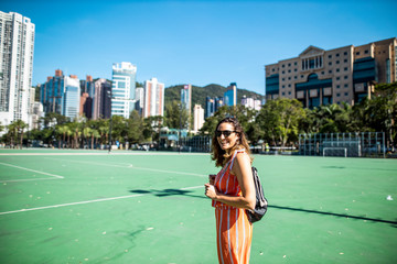 Hong Kong, Causeway Bay, Victoria Park, portrait of laughing woman on a sports field