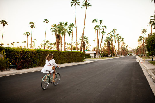USA, California, Palm Springs, woman riding bicycle on the street