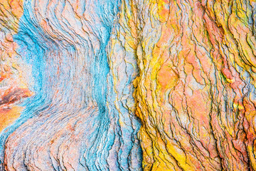 Colourful sedimentary rocks formed by the accumulation of sediments – natural rock layers...