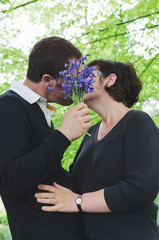 Man kisses girlfriend on a romantic date outdoors.