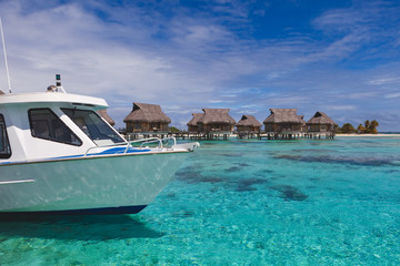 Water taxi boat arrives at beautiful tropical resort paradise in Tahiti