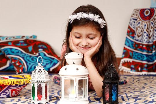 Greeting Card : Happy young Muslim girl playing with lantern in Ramadan