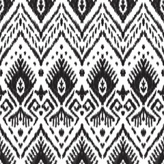 Black and white seamless background. Ethnic ikat ornament. Vector illustration. Tribal pattern. Can be used for textile, wallpaper, wrapping paper, greeting card backdrop, print.