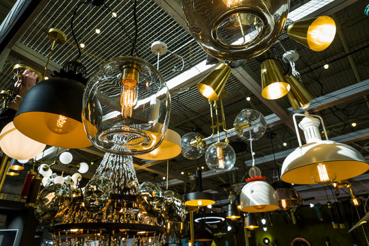 luminous chandeliers on a metal frame under the ceiling of the store