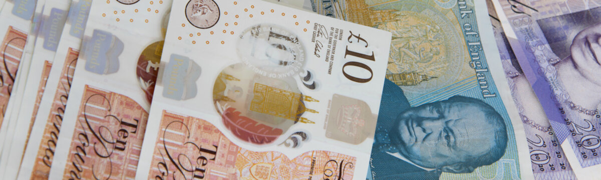 Closed up of different pound sterling banknotes. United Kingdom currency