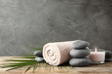 Estores personalizados con paisajes con tu foto Composition with zen stones, towel and candle on table against grey background. Space for text