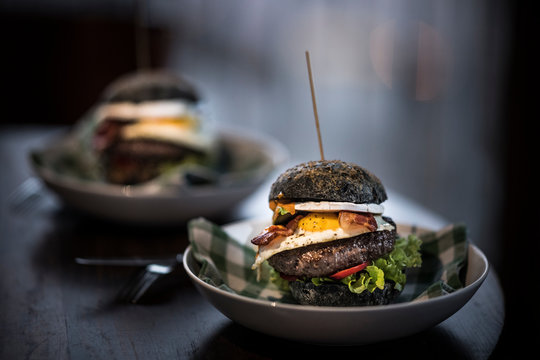 Black hamburgers with egg and bacon