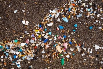 Microplastics on the sandy beach, washed up on dark lava sand, Playa Famara, Lanzarote, Canary Islands, Spain, Europe
