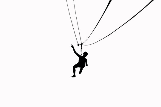Silhouette men are playing zip line on white background.