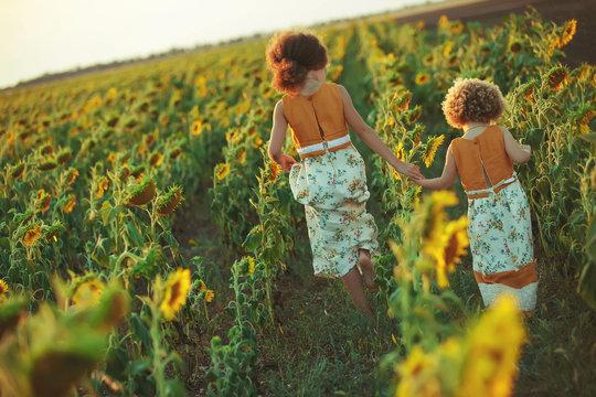 Children in sunflowers