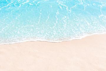 Soft wave of blue ocean on sandy beach. Summer Background. Copyspace