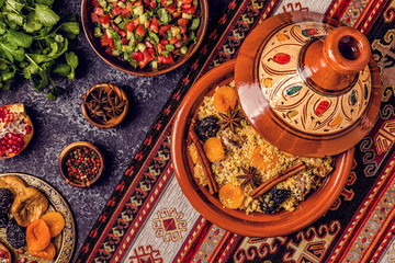 Traditional moroccan tajine of chicken with dried fruits and spices. Wall mural