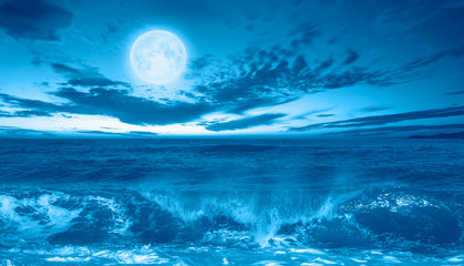 Wall Mural - Night sky with moon in the clouds with dark sea
