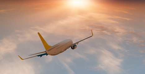 Keuken foto achterwand Vliegtuig White Passenger airplane in the clouds at sunset - Travel by air transport