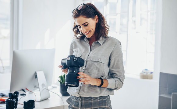 Female photographer checking pictures