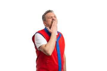 Hypermarket worker covering mouth as yawning.