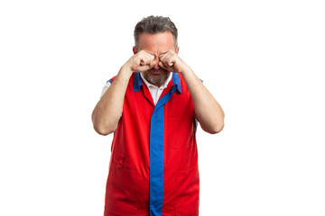 Hypermarket employee rubbing eyes as sleepy concept.