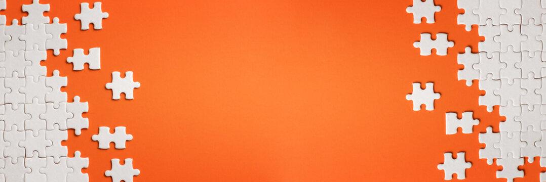 White details of puzzle on orange background