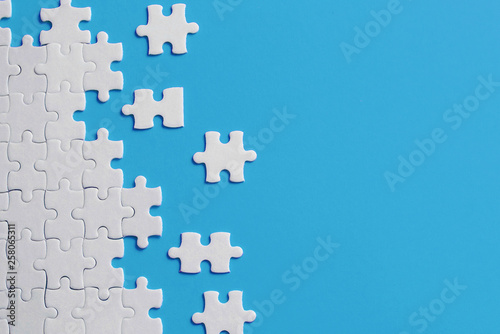 Wall mural White details of puzzle on blue background