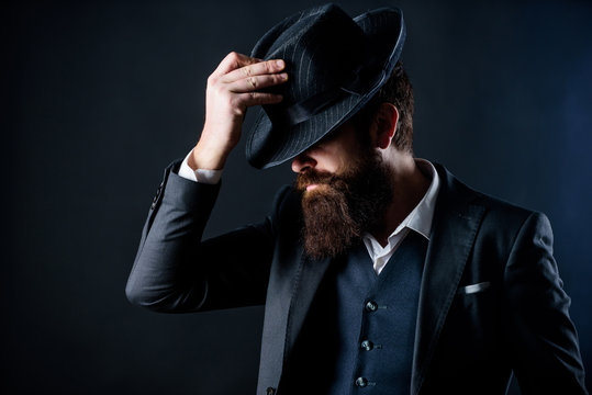 englishman club. Detective in hat. Mature hipster with beard. brutal caucasian hipster has moustache. Businessman in suit. Secret shy. Male formal fashion. Bearded man gentleman. fashioned englishman