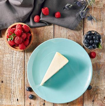 Classic Plain New York Cheesecake on Blue Plate