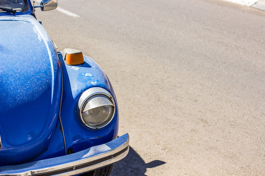 blue vintage car hood urban environment