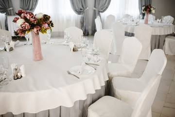 Idea of arranging the holiday table, crystal glasses on white background.