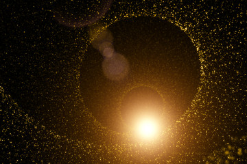 Gold colored blurry dots in the form of a spiral with magic light. Illustration background.