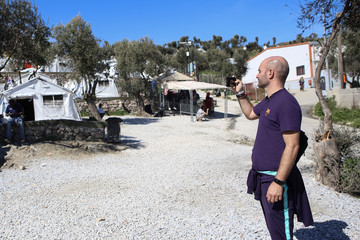 Barcelona FC former player Jordi Ferron takes pictures at the Moria camp for refugees and migrants on the island of Lesbo