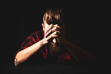 Tattooed praying man