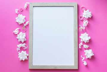 celebration White photo frame on pink background, birhday concept . white flowers and tape