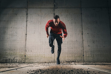 Athletic man sprinting