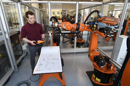 Bastian Remmel, an employee of German manufacturer of industrial robots and automation solutions KUKA