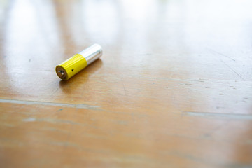 Yellow mix Silver Battery, Anode, Cathode om wooden texture background, Selective focus