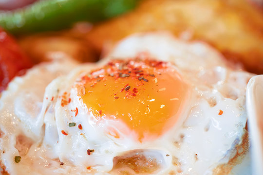 Photo of fried eggs close up, breakfast