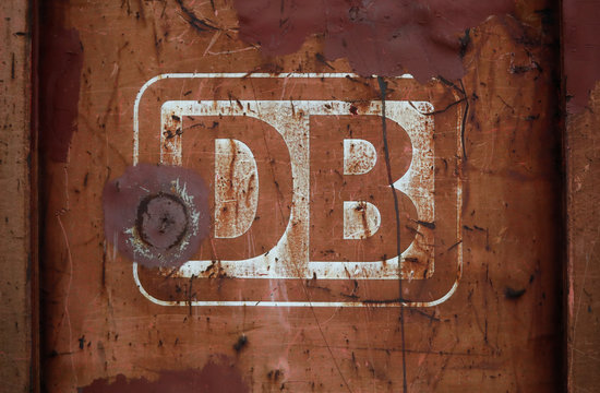 A rusted logo of Deutsche Bahn AG is pictured on a lorry that waits for demolition at a recycling firm in Leverkusen