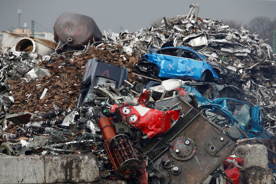 The remnants of cars and a red locomotive of German are seen at a recycling firm in Leverkusen
