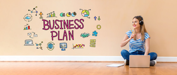 Business plan with young woman with headphones using a laptop computer and a pencil