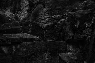 Stones texture, dark black and white background. Rock texture, natural
